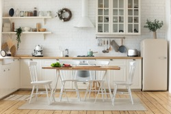 Interior design or bright white modern kitchen, fresh vegetables fruit wooden table, empty renovated furnished studio or flat apartment for rent, mortgage, real estate, renovation service concept