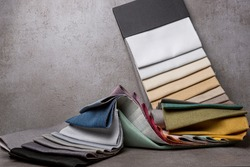 Interior design sample swaps of color shades in curtain fabric for comparison and options on stylish textured metallic colored surface and background