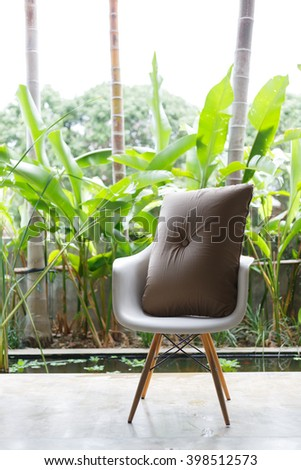 interior design, sofa furniture contemporary style in living room with natural garden outside the window #398512573