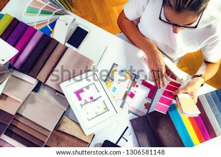 Interior designer, decorator, choosing  material samples in studio Stok fotoğraf ©