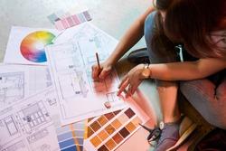 Interior designer draws plan with art tools
