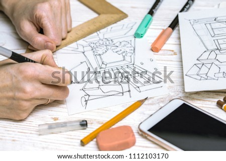 interior designer working on a sketch. background - drawing, markers, pencil, eraser, ruler, calculator