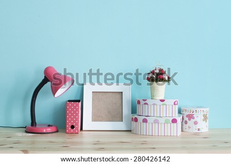 Interior detail. Home shelf with shabby chic decor on it over blue wall #280426142