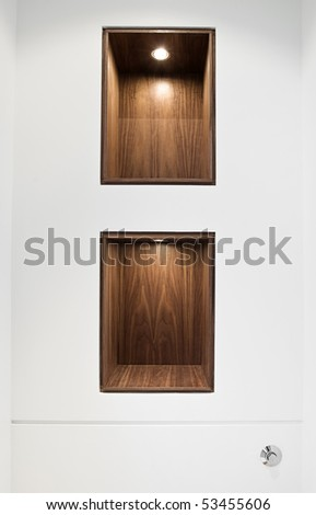 Interior Detail Shot of Walnut Shelving within a White Wall