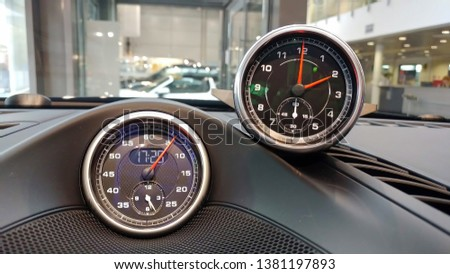 Interior details of a sports car. Sports chronometer with electronic clock or analog clock to choose from. Options for installation on the dashboard. #1381197893