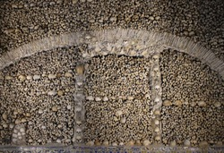 Interior elements of he Capela dos Ossos (English: Chapel of Bones) is one of the best known monuments in Évora, Portugal. The interior walls are covered and decorated with human skulls and bones.