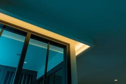 interior hidden LED lighting above window glass.