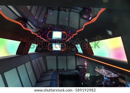 Interior inside the limousine with the ceiling in the style of the sky.