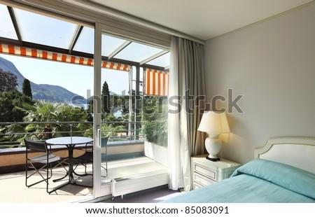 interior luxury apartment, comfortable bedroom,park view