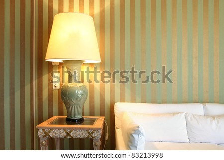 interior luxury apartment, comfortable suite, lamp and divan