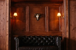 Interior made in the classical style of dark wood, the skull of the mountain goat, the library
