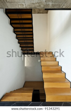 interior modern villa, wooden staircase - stock photo