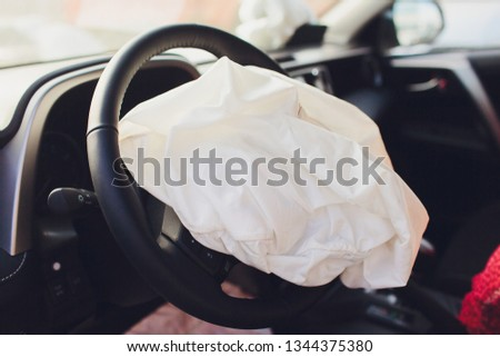 Interior of a automobile or car involved in a vehicle crash with a deployed steering column airbag. #1344375380