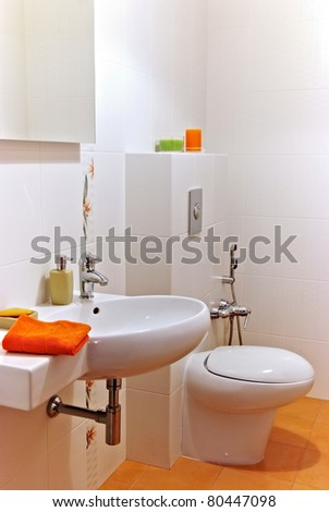 Interior of a bath room with sink and bawl