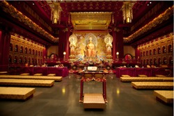 Interior of a Buddhist temple with many statues