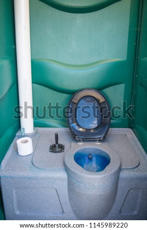 Interior of a clean portable toilet which are normally hired for outdoor events and building sites.