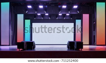 Interior of a conference concert hall or theatre with LED screen on scene and red seats #711252400