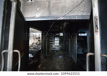 Interior of a factory damaged by fire / Damage caused by fire - Burnt interior #1099623551