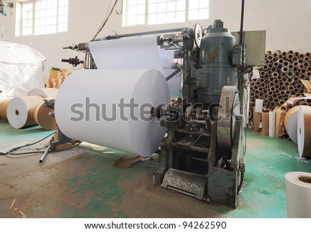 Interior of a factory, old machine for printing.