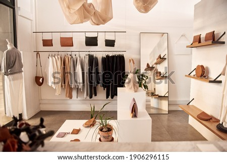 Interior of a fashionable clothing boutique full of an assortment of bags and accessories on display Сток-фото ©