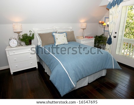 Interior of a girl's bedroom in shades of blue