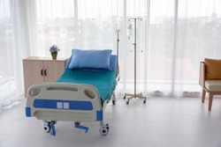 Interior of a hospital room with beds and medical equipment in a modern hospital with no patient.