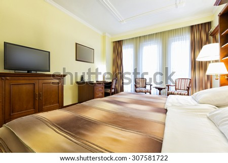 Interior of a hotel bedroom #307581722