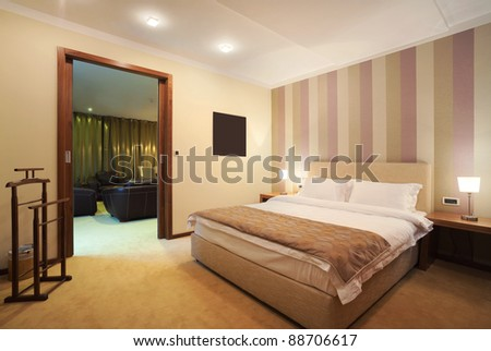 Interior of a hotel room for two, one part of a large apartment.