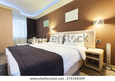 interior of a hotel room for...