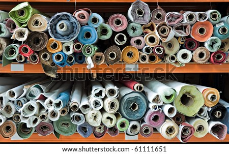 Interior of a industrial warehouse with fabric rolls. - stock photo