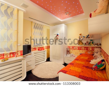 Interior of a kid room, modern design, with furniture and toys all around.