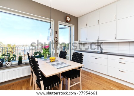 interior of a kitchen with dinging-table by the window with a view