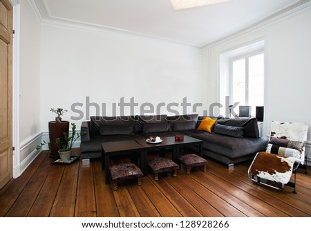 interior of a living room with a big sofa