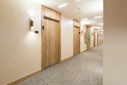 Interior of a long hotel corridor doorway