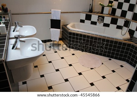 Interior of a modern bathroom. Black and white tiling