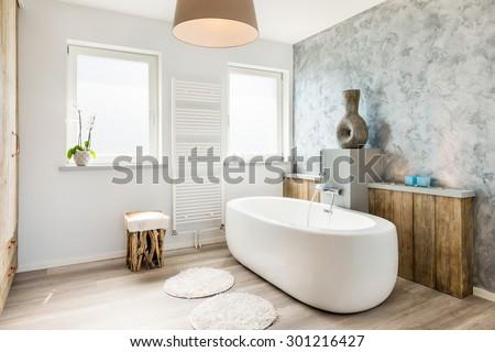 Interior of a modern bathroom with seperate bath