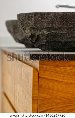 Interior of a modern bathroom with two stone sinks standing on brown furniture, washroom #1480269920