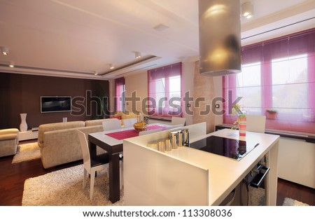 Interior of a modern home, view from kitchen on dining and living rooms. - stock photo