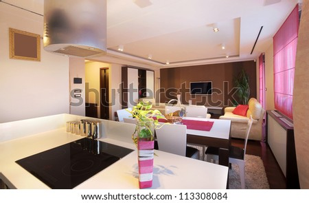 Interior of a modern home, view from kitchen on dining and living rooms.
