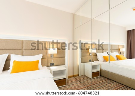 Interior of a modern hotel bedroom #604748321