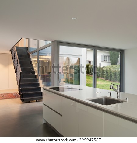 Interior of a modern house, wide open space with kitchen #395947567