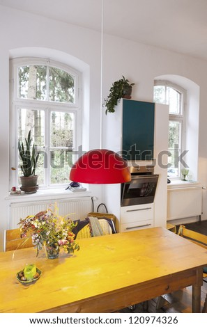 interior of a modern living-dining room in a country style home