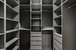 Interior of a modern loft style apartment. Gray wardrobe