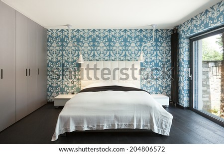 interior of a modern villa, beautiful bedroom, double bed