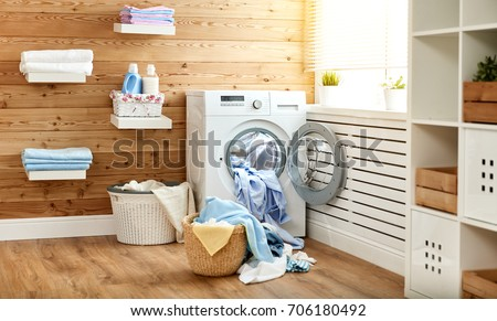 Interior of a real laundry room with a washing machine at the window at home #706180492