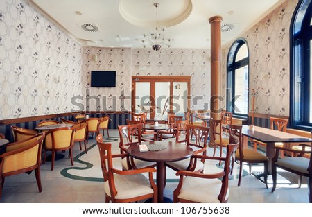 Interior of a restaurant, vintage style, during day.