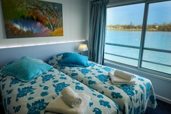 interior of a room or living cabin on a cruise ship with a view of the river Garonne, Bordeaux (France)