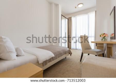 Interior of a single bed  hotel bedroom