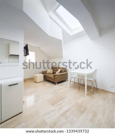 Interior of a studio flat with white wall, nobody inside
