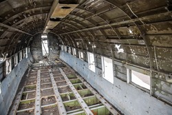 interior of a textured and abandoned airplane with soft light